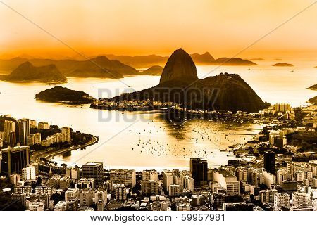 Rio de Janeiro Brazil. Suggar Loaf and Botafogo beach viewed from Corcovado at sunset. poster