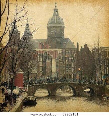The  Oudezijds Voorburgwal is a street and canal in downtown Amsterdam,  Netherlands . Photo in retro style. Paper texture. poster