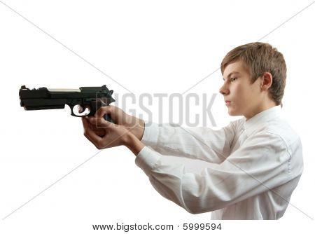 Young Man Aiming A Black Gun