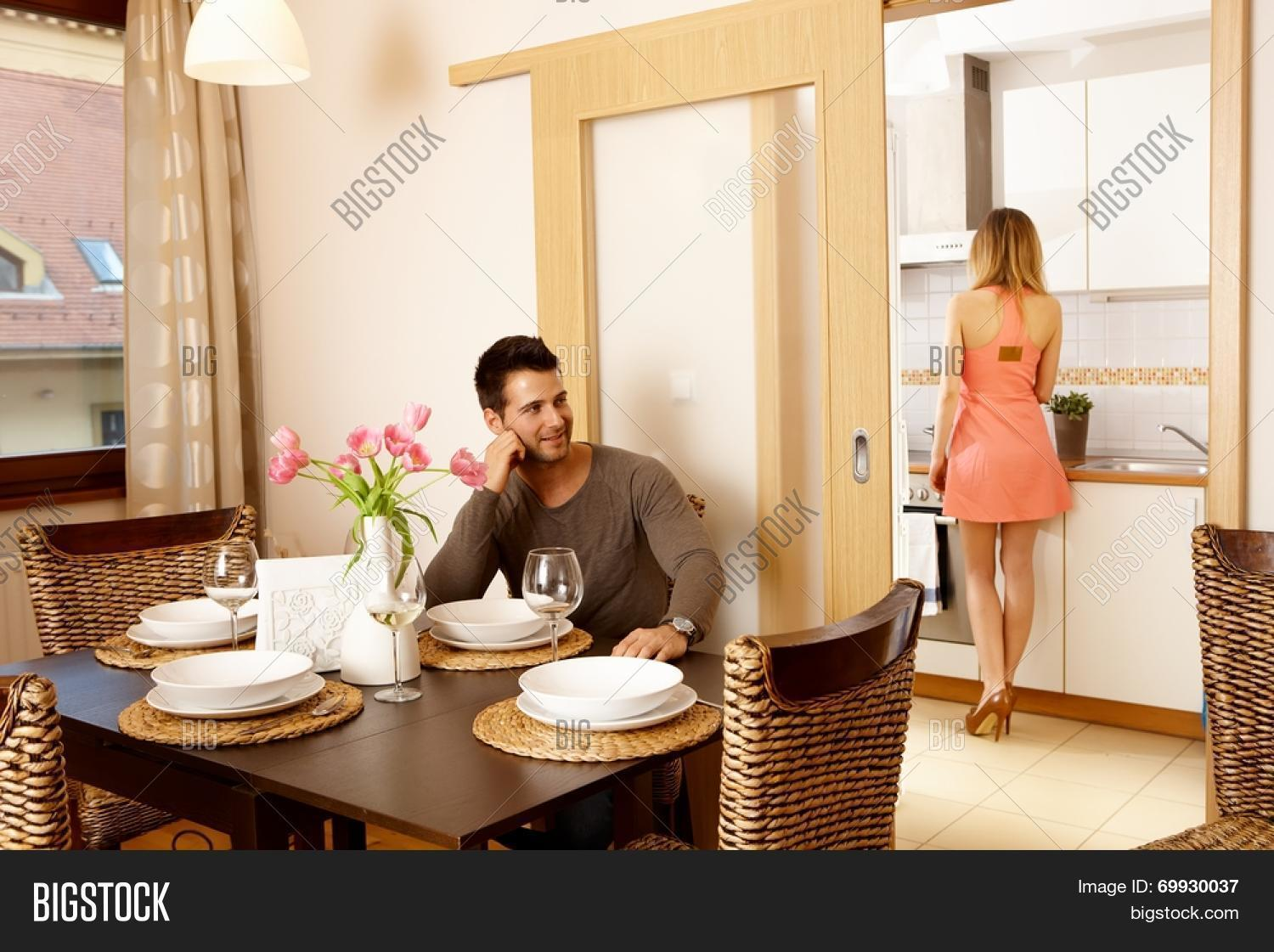Young Waiting For Dinner Guests At Home Woman In Kitchen Cooking