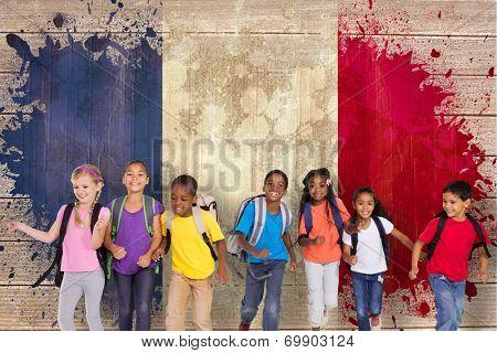 Elementary pupils running against france flag in grunge effect poster