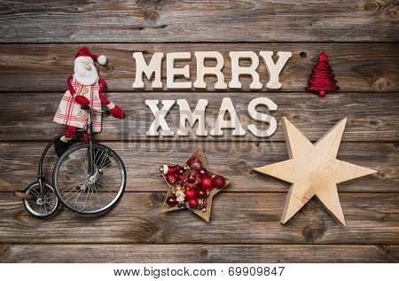 Merry Xmas Greeting Card With Text. Red Santa Claus On Wooden Rustic Background.