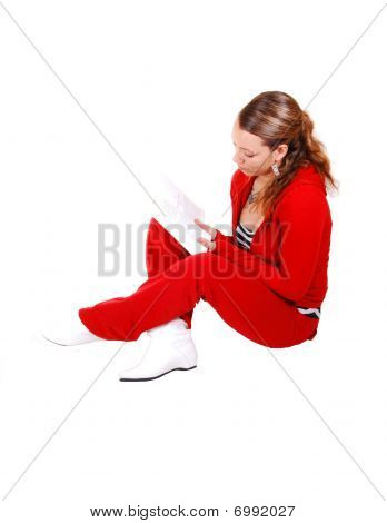 Girl Sitting On Floor And Reading.