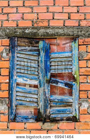 Old windows on red brick wall