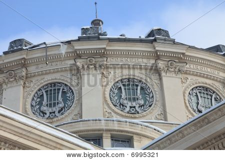 Architectural detail during the winter of the Romanian Athenaeum from Bucharest.Under the roof is the name of Raphael Corneille and Virgilius. poster