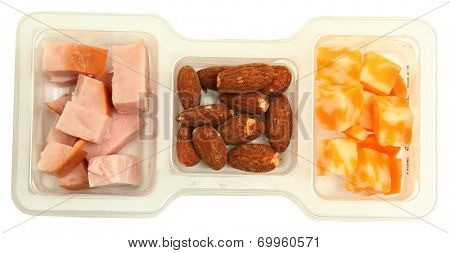 Three piece protien snack pack with salted almonds, smoked turkey and marble cheddar cheese.