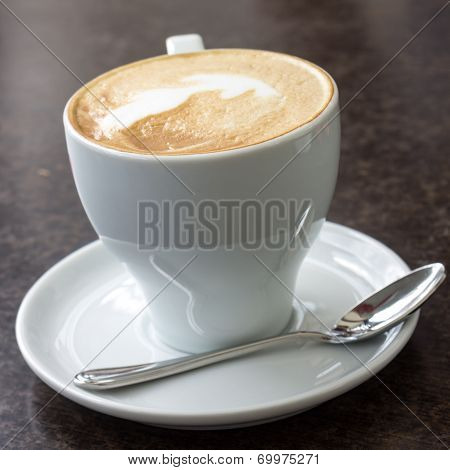 Cup Of Cappuccino Served In Cafe