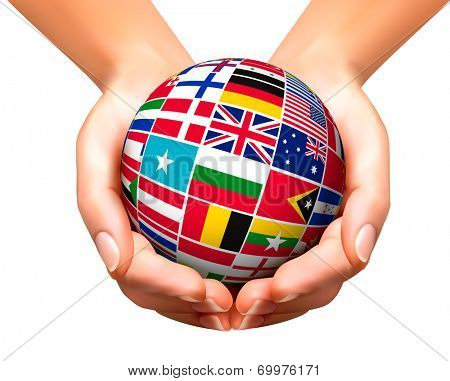 Flags of the world in globe and hands.