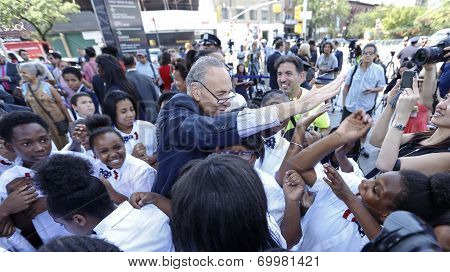 Senator Schumer high-fiving kids
