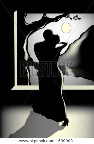 Two people dancing at night under the moon