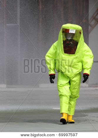 Rescuer With The Yellow Suit Against Biological Hazard From Contamination 1