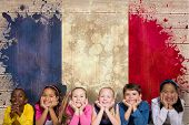 Cute pupils smiling at camera against france flag in grunge effect poster