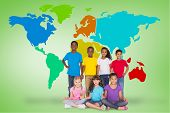 Elementary pupils smiling against green vignette with world map poster
