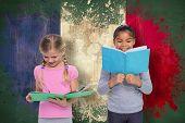 Elementary pupils reading against france flag in grunge effect poster