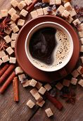 Brown sugar, spices and cup of coffee on wooden background poster