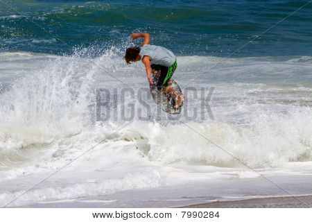 Skimboarder Competes