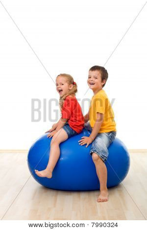 Kids Jumping On A Large Rubber Ball