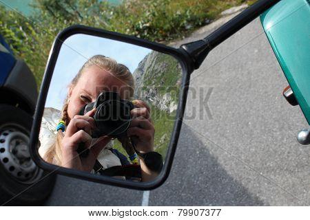Selfie on the motobike mirror.