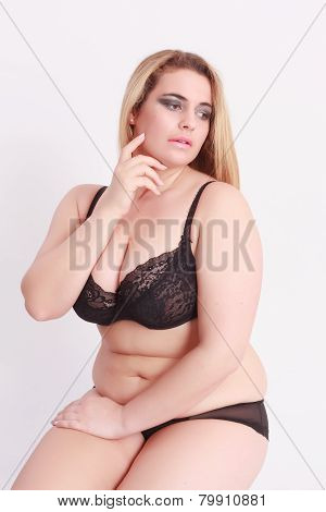 Sensual young woman with oversize in lingerie