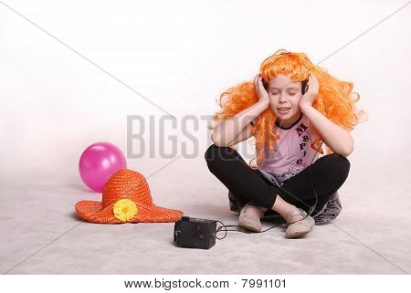 Young Redhead Girl / Child Listening To Music With Headphones Against White Background