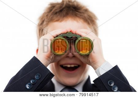 Little smiling child boy in business suit hand holding binoculars lens looking for direction white isolated