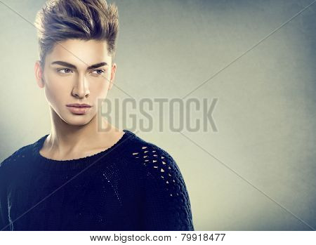 Fashion young model man portrait. Handsome Guy. Vogue style image of elegant young man