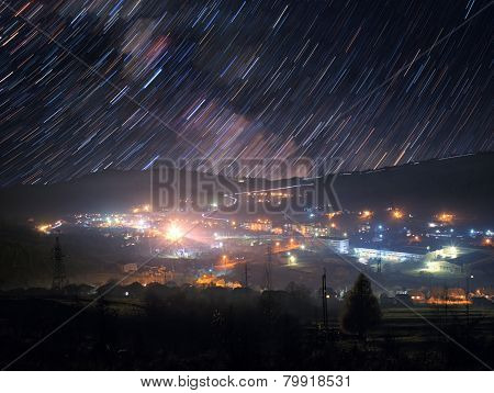 Star Trails Over Mountain Town