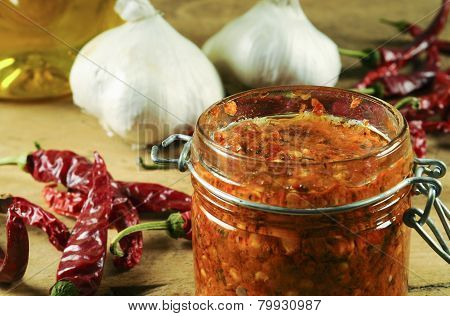 Hot and spicy harissa sauce in a jar