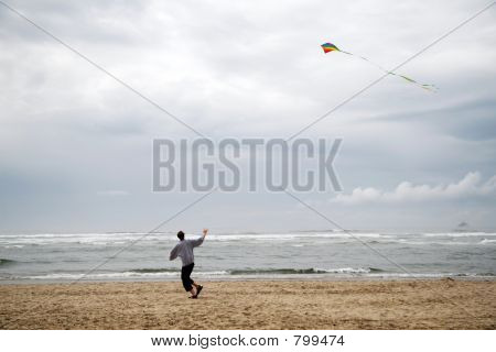 Man Flying Kite