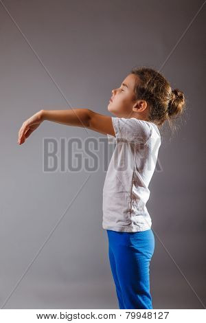 baby girl sleeping lunatic standing on gray background