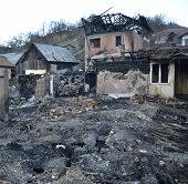 Burnt down house completely damaged by fire poster