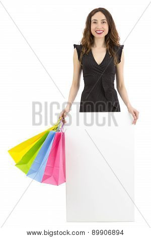 Shopping Woman Holding A Blank Poster
