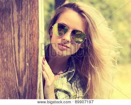 Pretty Fashion Hipster Girl in Glasses Peeking