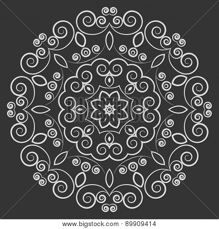 Round lacy vintage pattern on black background