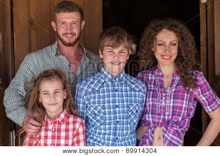 father mother daughter and son closeup family of four portrait focus on children