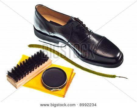 poster of Shoe shine concept with shiny black shoe and polish, brush and cloth