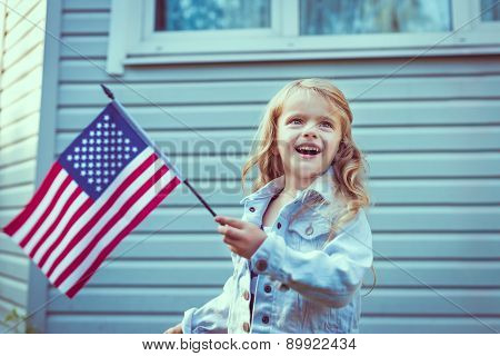 Pretty Little Girl With Blond Hair Smiling And Waving American Flag. Independence Day, Flag Day