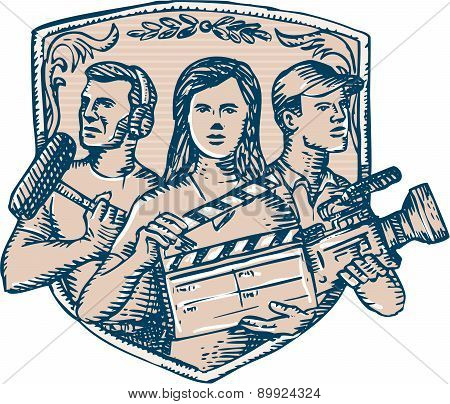 Etching engraving handmade style illustration of a film crew cameraman soundman with clapperboard microphone video film camera set inside shield crest. poster