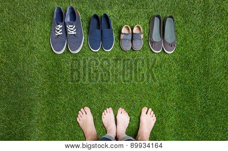 Couple legs and shoes standing  on grass