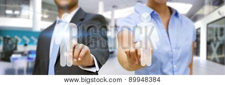 Man And Woman Using Digital Interface