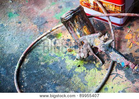 Spary Gun On Floor Abstract