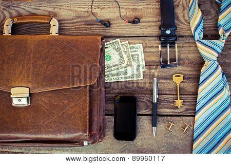 Men accessories: cufflinks, dollars, strap, pen, mobile phone, headphones, belt, document bag and ke