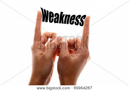 """Color horizontal shot of a two hands squeezing the word """"weakness"""". poster"""