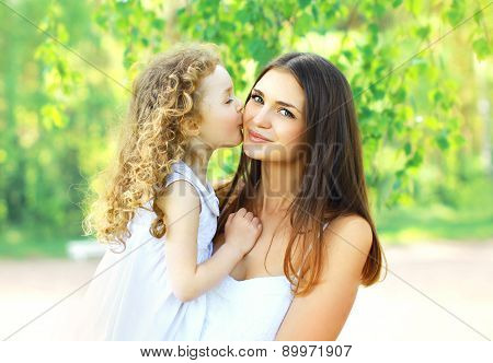 Mother's Day, Family, Childhood And People Concept - Loving Daughter Kissing Mother, Happy Young Mom
