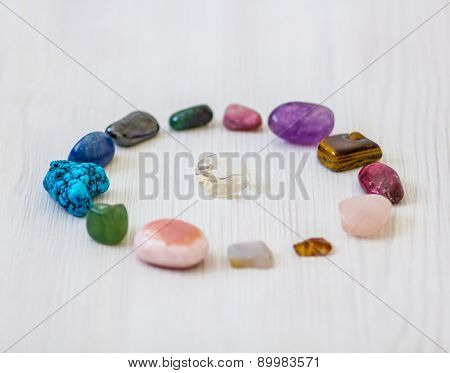 Crystals in shape of circle with clean quarz stone in middle, evry with different energy for spiritual and body healing poster