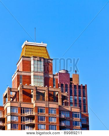 Facade Of  Buildings In The Afternoon With Iron Man Statue O From  Antony Gormley On The Roof