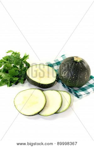 Rotund Raw Zucchini On A Checkered Napkin