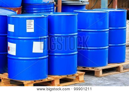Big Blue Barrels On Wooden Pallets