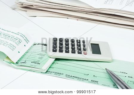 Checkbook, Pen And Calculator