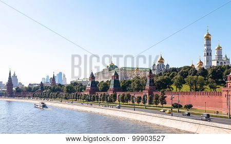Moscow skyline - panoramic view of The Kremlin embankment Kremlin buildings walls towers Moscow City in summer afternoon poster